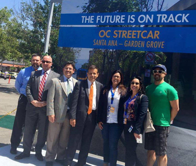 Michele Martinez, third from right, at the announcement for Orange County's planned street car. Martinez has been one of the biggest advocates of active transportation in Santa Ana. Photo Courtesy of Michele Martinez. From left, Jason Gabriel, Santa Ana Public Works Agency; Fred Mousavipour, Executive Director of Santa Ana Public Works Agency; William Galvez, Public Works Agency; Santa Ana Mayor Miguel Pulido; Michele Martinez, Santa Ana Ward 2 council member; Alma Flores, Santa Ana public information officer; Sean Coolidge, Historic Resource Commissioner.