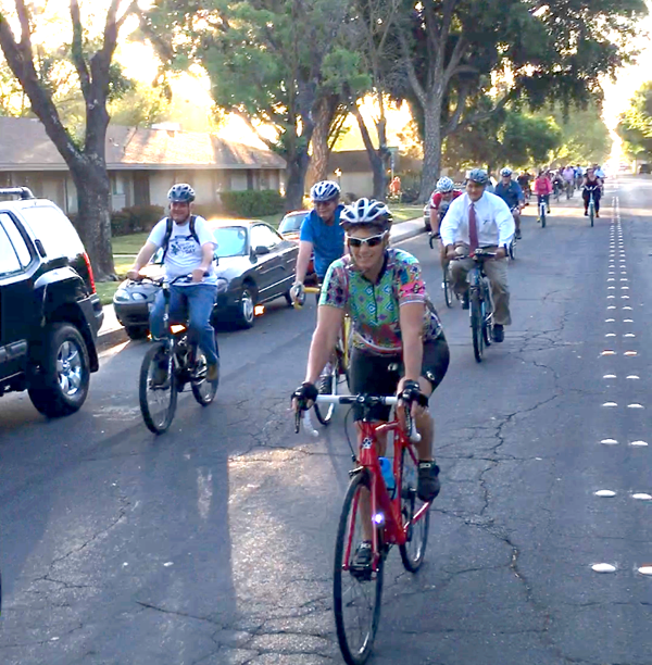 Modesto Mayor (left) is joined by City Councilmember Tony Madrigal (with tie) on Bike to Work Day. Photo: Michael Sacuskie