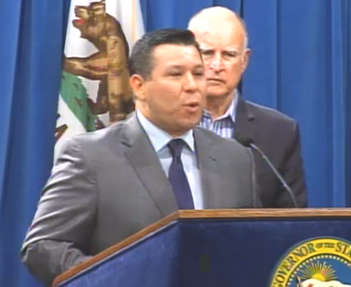 Assemblymember Eduardo Garcia (D-Coachella Valley), flanked by Governor Jerry Brown, addresses the press after two major climate change policy bills passed.